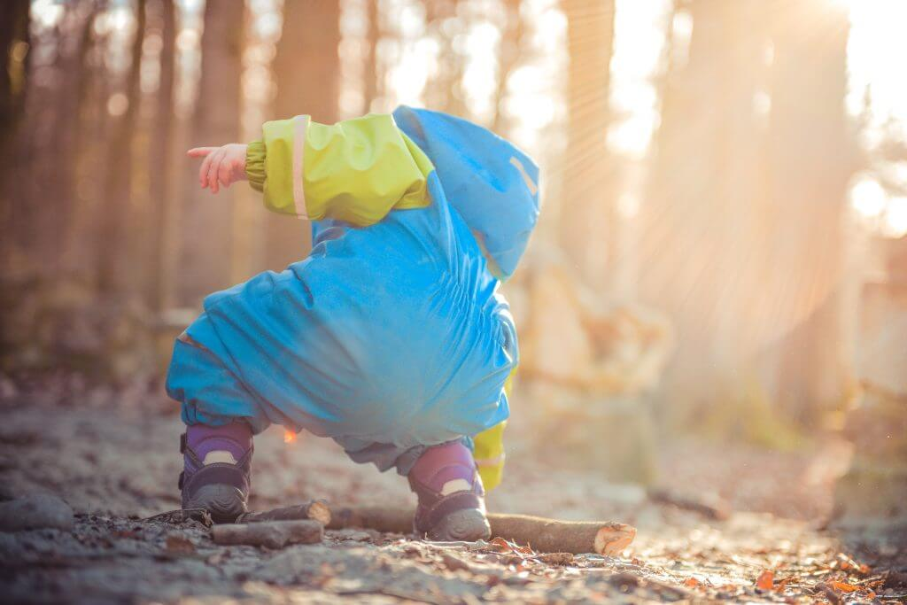 Toddler Picking Up Stick Forest School Activity
