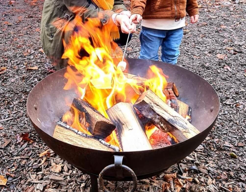 Building a campfire is a fun activity to do with your toddler outside