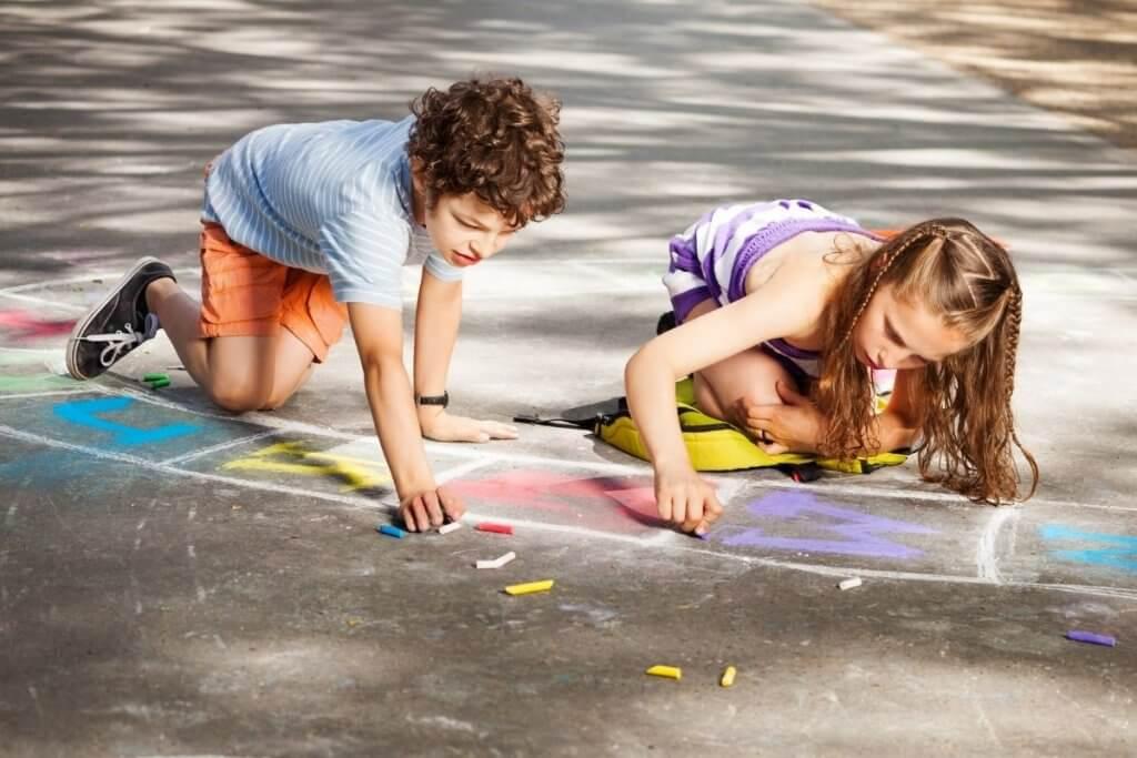 Outdoor Literacy Activities, Kids Using Chalk Outdoors